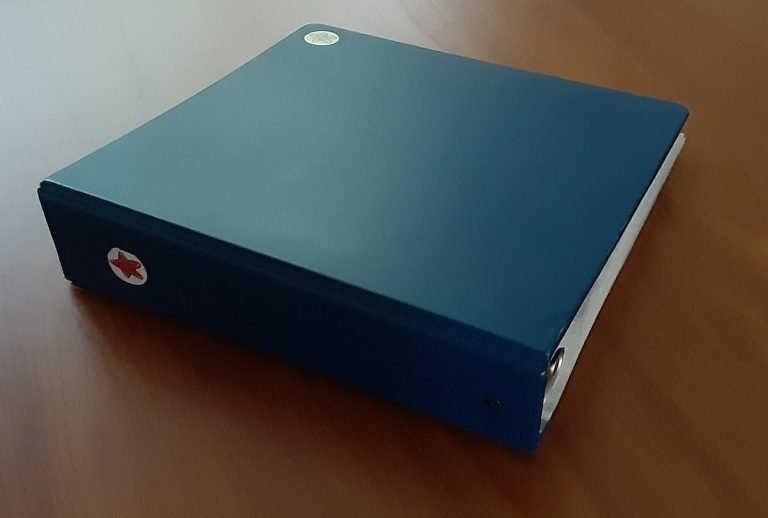 Blue 3-ring binder full of Mom's important documents