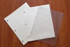 clear plastic sheet protectors and slash pockets for important documents notebook