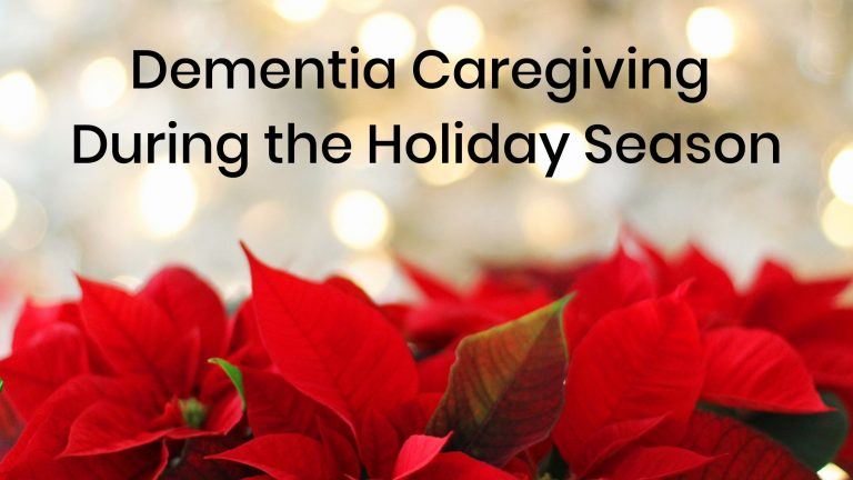 Several Poinsettias in the foreground with while lights in the background, the words Dementia Caregiving During the Holiday Season written at the top