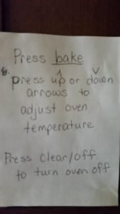 photo showing directions for how to turn on the kitchen oven, written for Mom who had dementia