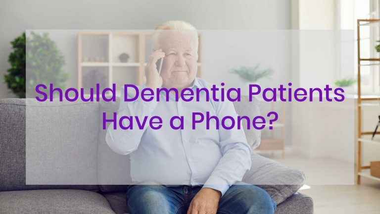 Elderly man sitting on couch with a smartphone up to his ear