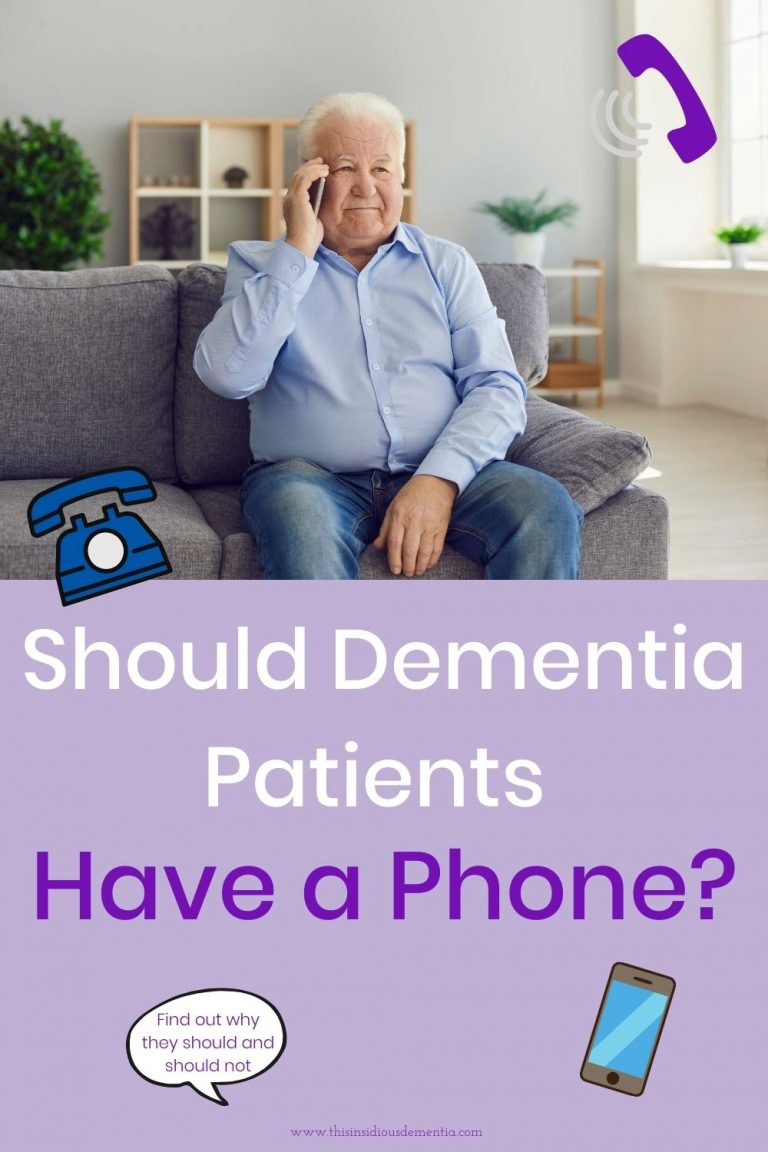 Elderly man sitting on couch with a cell phone to his ear